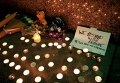 Импровизированный мемориал в честь жертв теракта в Париже