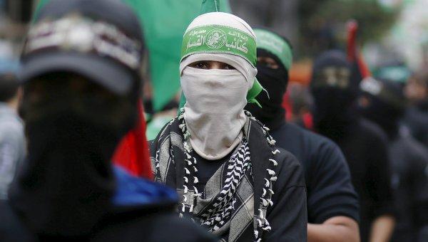 Палестинец в маске ХАМАС. Архивное фото