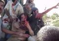 Опубликовано новое видео последних минут жизни Каддафи. Видео