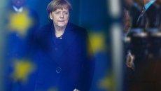 Канцлер Германии Ангела Меркель на фоне флага ЕС