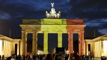 Дань памяти жертвам теракта в Брюсселе