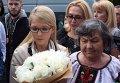 Тимошенко и мать Савченко в эропорту Борисполя