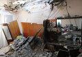 Последствия обстрела жилого дома в Донецке