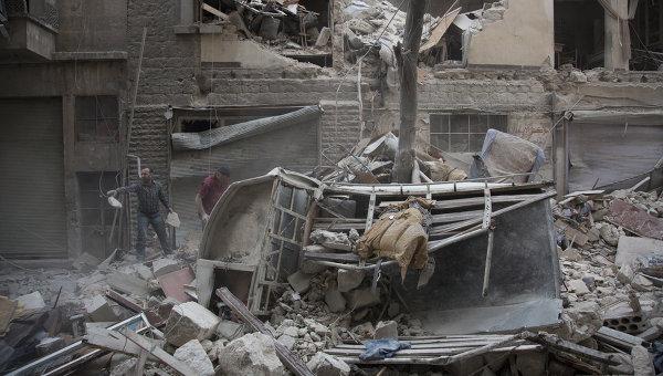 Последствия обстрела сирийского города Алеппо