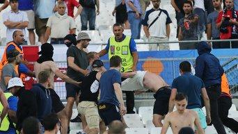 Драка на трибуне болельщиков после матча группового этапа чемпионата Европы по футболу.