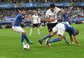 Игрок сборной Италии Андреа Барцальи, игрок сборной Германии Матс Хуммельс и игрок сборной Италии Стефано Стураро