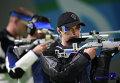 Владимир Масленников на соревнованиях по пулевой стрельбе на 10 метров из пневматической винтовки среди мужчин на XXXI летних Олимпийских играх.