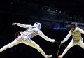 Рио-2016. Французский фехтовальщик вышел на поединок с телефоном. Видео