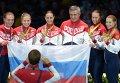 Спортсменки сборной России, завоевавшие золотые медали в командном первенстве по фехтованию на саблях среди женщин на XXXI летних Олимпийских играх