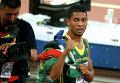 Уэйд ван Никерк (Южная Африка) после финального забега на 400 метров