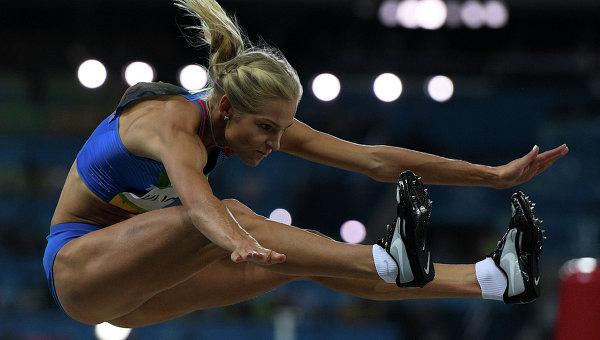 Дарья Клишина (Россия) во время квалификационных соревнований по прыжкам в длину