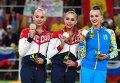 Призеры индивидуального многоборья в художественной гимнастике: Яна Кудрявцева - серебряная медаль, Маргарита Мамун - золотая медаль, Анна Ризатдинова - бронзовая медаль, на церемонии награждения.