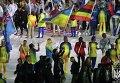 Бронзовый призер Олимпиады Ольга Харлан со знаменем Украины на церемонии закрытия Игр