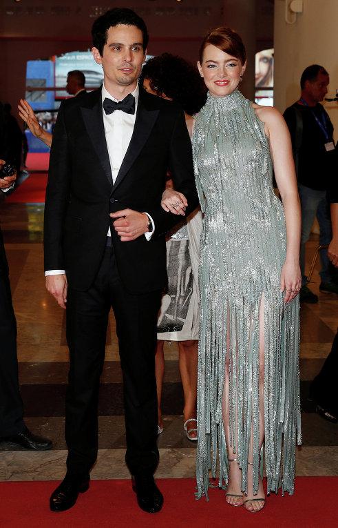 Венецианский кинофестиваль. Кинорежиссёр Дэмьен Шазелл и американская актриса Эмма Стоун.