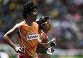 Даниэла Евгения Веласко Мальдонадо (Мексика) и гид Габриэль Энрике Урбина Леонор в забеге на 1500 метров