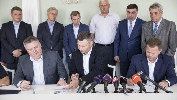 Столкновения настройках: Киевские власти, милиция изастройщики подписали меморандум осотрудничестве
