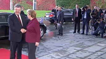 Меркель в Берлине встречает Порошенко, Олланда и Путина. Видео