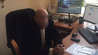 В Киевской области глава сельсовета требовал $ 14 тысяч взятки от переселенца