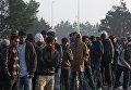 Расселение стихийного лагеря беженцев в Кале во Франции