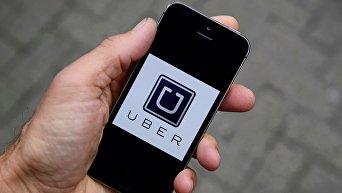 Приложение мобильного телефона с сервисом такси Uber
