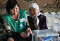 Голосование на выборах в Киргизии. Архивное фото