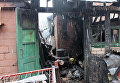 Последствия пожаров, возникших из-за обстрелов в Донбассе. Архивное фото