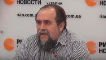 Охрименко: от дестабилизации валютный рынок спасают гастарбайтеры. Видео