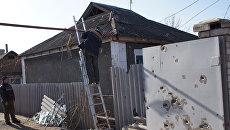 Последствия обстрела жилого сектора Стаханова в ЛНР
