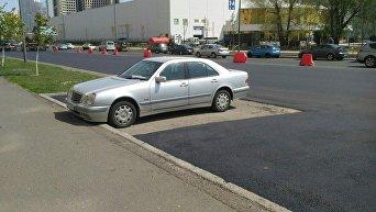 Ремонт дорог возле МВЦ в Киеве с островком для Mercedes