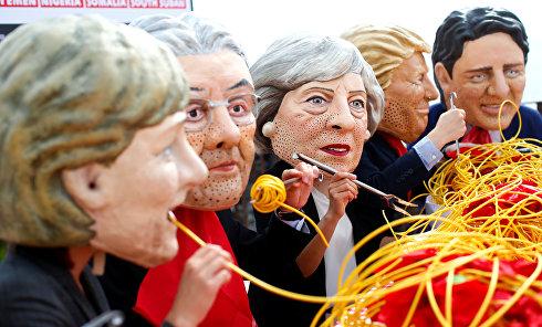 Маскарад на саммите G7: активисты накормили мировых лидеров лапшой