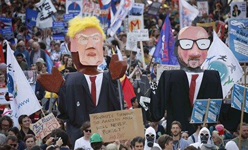 Тысячи человек вышли в Брюсселе на протестные митинги против НАТО и приезда президента США Дональда Трампа.