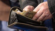 Деньги и кошелек. Архивное фото