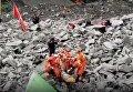Спасательные работы на месте оползня в Китае