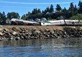 Поезд, перевозивший более 200 пассажиров, сошел с рельсов в штате Вашингтон