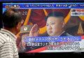 Мужчина в Токио (Япония) смотрит на уличный монитор, показывающий новости о Северной Корее, которая провела испытания баллистической ракеты