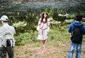 Девушка в венке из полевых цветов на Ивана Купала