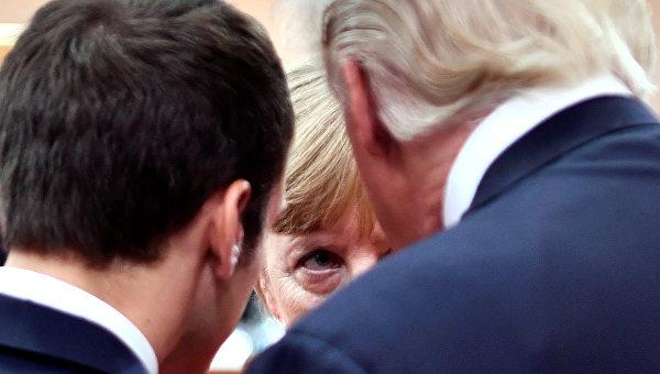 Президент Франции Эммануэль Макрон, канцлер Германии Ангела Меркель и президент США Дональд Трамп. Архивное фото