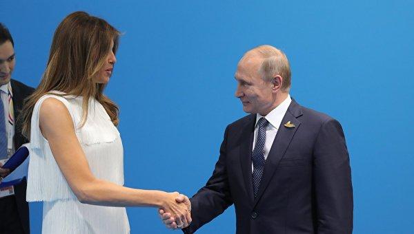 Супруга президента США Мелания Трамп и президент РФ Владимир Путин на саммите G20