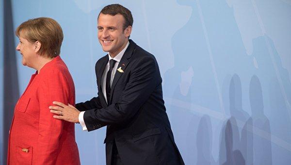 Президент Франции Эммануэль Макрон и канцлео Германии Ангела Меркель на саммите G20 в Гамбурге