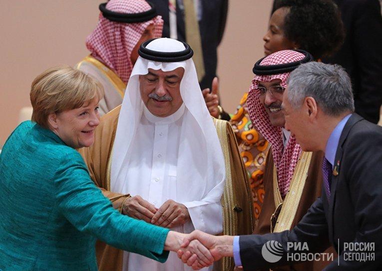 Канцлер Германии Ангела Меркель и государственный министр Саудовской Аравии Ибрагим Абдулазиз аль-Ассаф