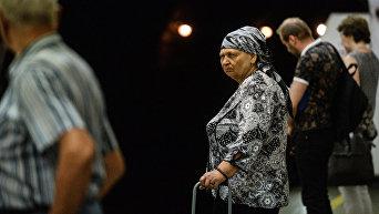 Пожилая женщина в Киеве