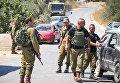 Израильские военные на месте теракта на Западном берегу