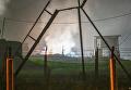 На месте пожара на складе с боеприпасами на территории воинской части в населенном пункте Галичный Комсомольского района Хабаровского края России, 29 июля 2017