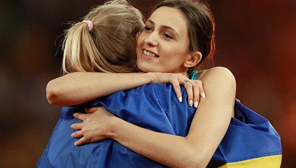 Мария Ласицкене (АNA) в финальных соревнованиях по прыжкам в высоту среди женщин на чемпионате мира 2017 по легкой атлетике в Лондоне