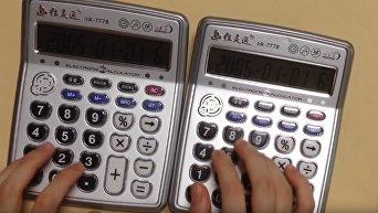 Японец исполнил хит Despacito на двух калькуляторах