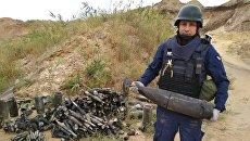 Пиротехники изъяли 150 взрывоопасных предметов при ликвидации последствий пожара на военном складе вблизи Мариуполя в Донецкой области