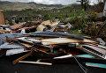 Обломки дома, поврежденного ураганом Мария у Сан-Хуана, Пуэрто-Рико