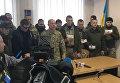 Илья Кива в суде в сопровождении мужчин в камуфляже по делу Авакова
