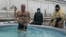 Заключенные одесского СИЗО окунулись в крещенскую купель