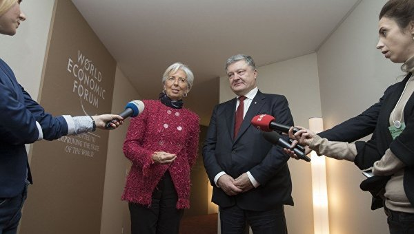 Президент Украины Петр Порошенко и директор-распорядитель МВФ Кристин Лагард. Архивное фото
